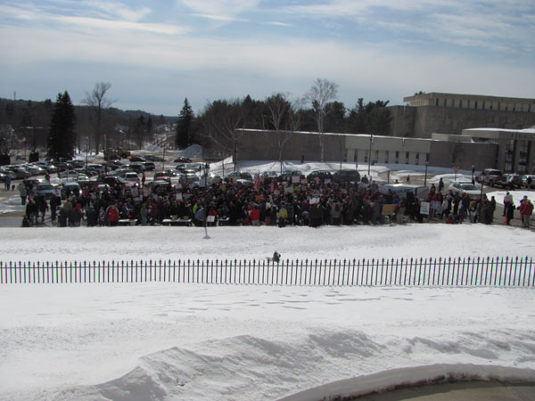 More than 300 people turned out Saturday for a rally at the State House in Augusta in attempt to show solidarity with  union-friendly protesters in Wisconsin. While some of the participants appeared to be part of a national day of rallies organized by the liberal group MoveOn.org, others said they were union workers in Maine who are concerned about provisions of the biennial budget proposed by Gov. Paul LePage. Participating in a counter-rally not far away were approximately 50 people, many of whom said they were part of the tea party movement.