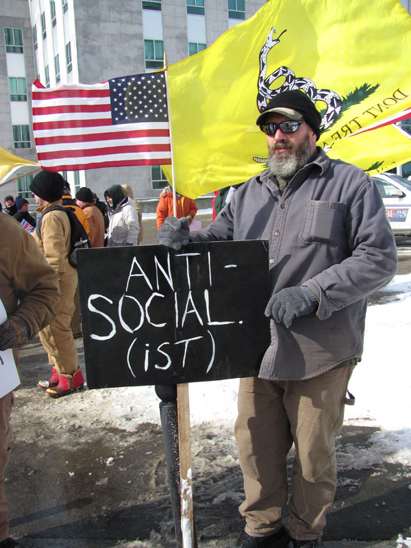 Rick Hanson, a farmer from Plymouth, stands with a group of fiscal conservatives, many of them part of the Maine Tea Party Patriots, on Saturday. He said Saturday's event was his first foray into social activism.
