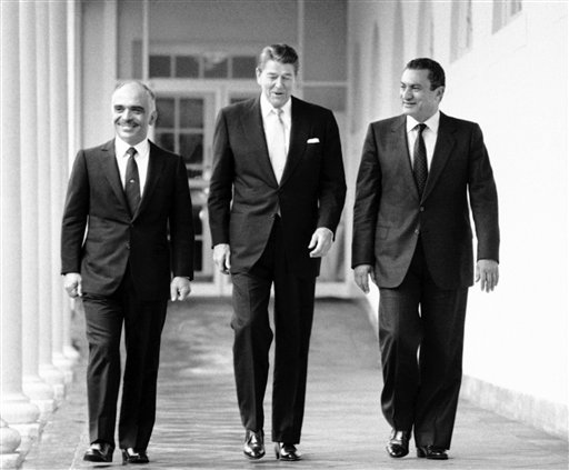 In a Feb. 14, 1984 file photo, President Ronald Reagan, center, King Hussein of Jordan, left, and President Hosni Mubarak of Egypt walk along the colonnades at the White House. Mainers and those from around the country honored Reagan on what would have been his 100th birthday.