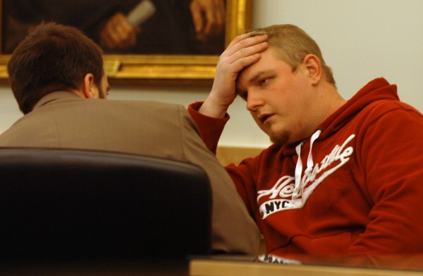 David Churchill of Fort Fairfield (right) speaks with his attorney Hunter Tzovarras during his sentencing at the Penobscot Judicial Center on Tuesday, Feb. 1, 2011. Twenty-six-year-old Churchill was sentenced to 30 months with all but 12 suspended for unlawful sexual contact with a 12-year-old girl in 2009.