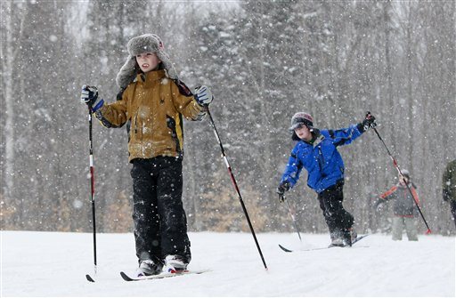 Third-grader Aidan Brown, left, and classmates cross country skis during a physical education class at the New Sweden Consolidated School in New Sweden, Maine. Students from the first grade on up ski on groomed trails in the woods just behind the elementary school.