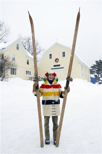 Suzy Anderson shows off a pair of wooden skis used by her grandfather in Stockholm, Maine.  The Swedes brought skiing with them when they immigrated to Aroostook County starting in the 1870s.  They used skis to get around when winter snows shut down the roads.