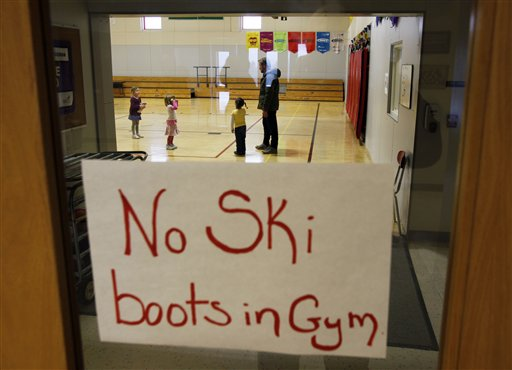 A sign reminds students to remove their ski boots at the New Sweden Consolidated School in New Sweden, Maine.