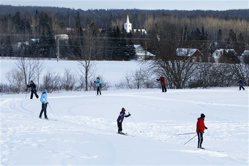 Ski coach Ernie Easter leads his team during after school cross country skiing practice at the New Sweden Consolidated School in New Sweden, Maine.