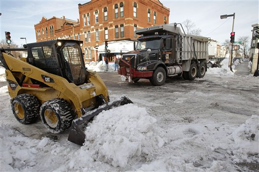 snow removal crew cleans up the street in the Southie neighborhood of Boston, Monday afternoon, Jan. 31, 2011. The area is expecting another mid-week winter storm.