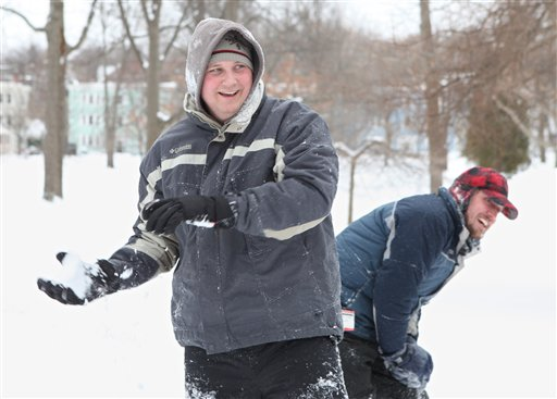 Tim Roberts, left, and Shawn McNutt, right, participate in a snowball fight Wednesday, Feb. 2, 2011 at Deering Oaks Park in Portland, Maine.