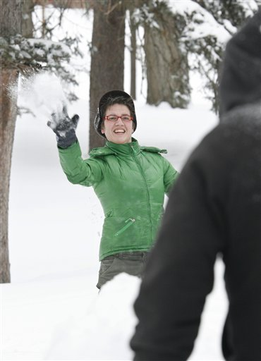 KT Crossman, throws a snowball Wednesday, Feb. 2, 2011 during a snowball fight at Deering Oaks Park in Portland, Maine.