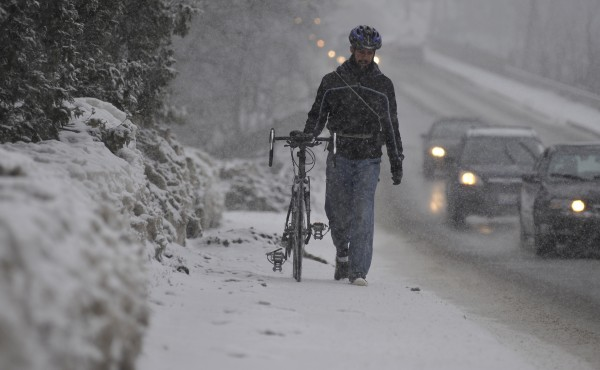 As the snow started to accumulate late Friday morning, Philip Andresen of Rockland, a third-year physics major at the University of Maine in Orono, walked his bike back to his apartment in Old Town. &quotI biked to school this morning and halfway back, I started slipping so I decided to hoof it,&quot he said.