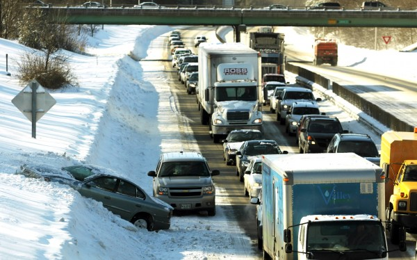 Traffic along Interstate 95 northbound near the Ohio Street in Bangor slows to a crawl as several cars spun out on the slippery surface on Thursday morning.
