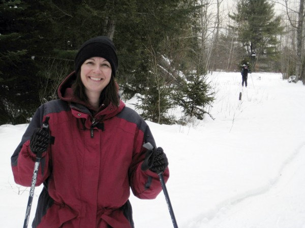 Julie Dickey, from Hudson, is all smiles over the conditions on the ski trails at Treworgy's Family Orchards free ski event held last Saturday at the site of a planned Nordic ski center at the farm in Levant . &quotThe conditions are excellent,&quot she said, of the groomed trails.