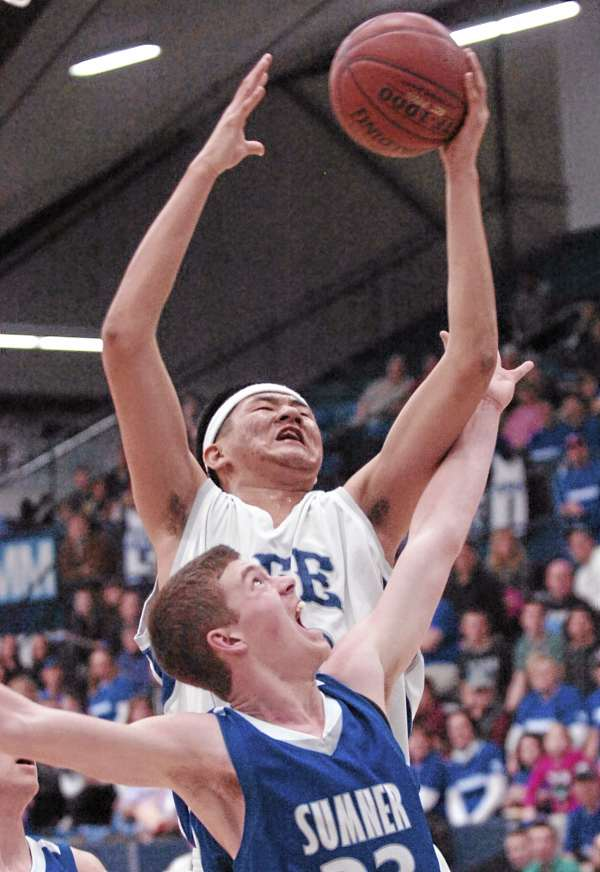 Daniel He of Lee's Academy goes up for a shot over Sumner of East Sullivan's Xavier Tracey during the first half of their Eastern Maine Class C boys championship game Tuesday at Alfond Arena in Orono. Lee won 64-42.