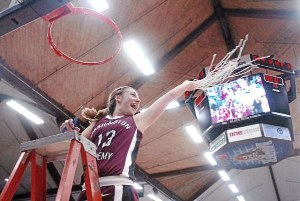 Taylor Seeley, a senior starter for the Washington Academy of East Machias girls basketball team, doesn't mind seeing herself on the Alfond Arena video screen as she waves the net in celebration following her Raiders' 42-39 victory over Orono in Tuesday night's Eastern Class C championship game. It was the first high school tourney game played at Alfond and players, coaches and fans enjoyed the experience. Players did have some adjustments to make as a reflection of the video screen could be seen on the backboards and the floor is 10 feet longer (94 feet) than the Bangor Auditorium's.