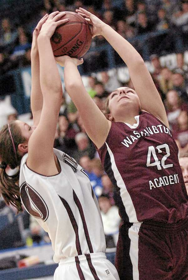 Kayleigh Bridges (right) of Washington Academy of East Machias takes control of the ball from Orono's Jillian Woodward during the second half of the Eastern Maine Class C girls basketball championship game Tuesday at Alfond Arena in Orono. WA won 42-39.