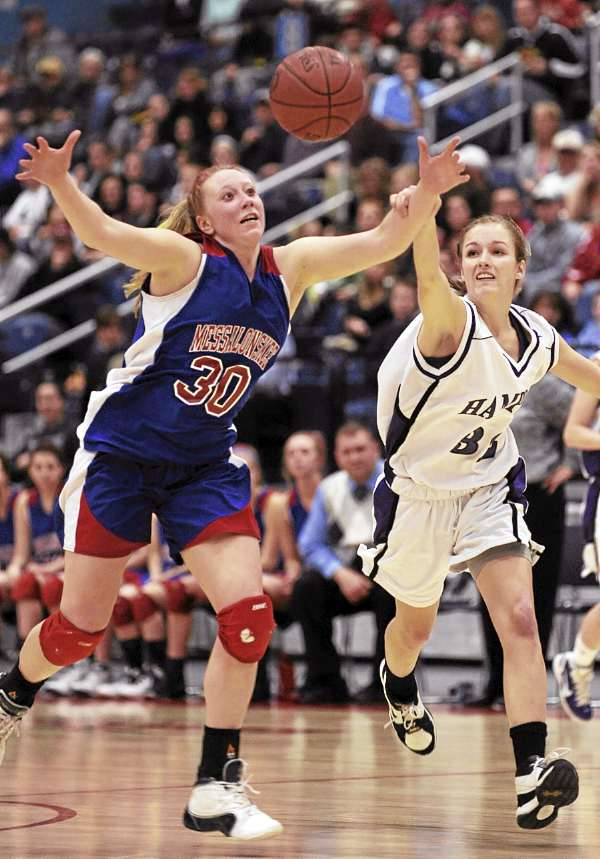 Hampden Academy's Sarah Lamberton grabs the wrist of Messalonske player Mickelle McCafferty during second-half action on Tuesday, March 1, 2011 at the Augusta Civic Center during Class A Eastern Maine Finals. Hampden won 62-40.