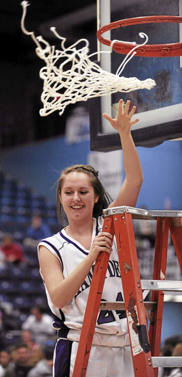 Hampden's Ellie Webb tosses the net to her teamates after cutting it from the hoop after the Broncos defeated Messalonskee 62-40 at the Augusta Civic Center on Tueday, March 1, 2010.