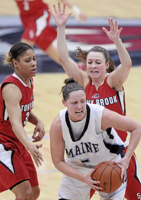 Tanna Ross (center) of the University of Maine looks for a teammate to pass to during a game against Stony Brook earlier this year. Seawolves Kirsten Jeter (left) and Sam Landers try to contain Ross. Ross and the Black Bears take on the Seawolves on Thursday in the opening round of the America East tournament in Hartford, Conn.