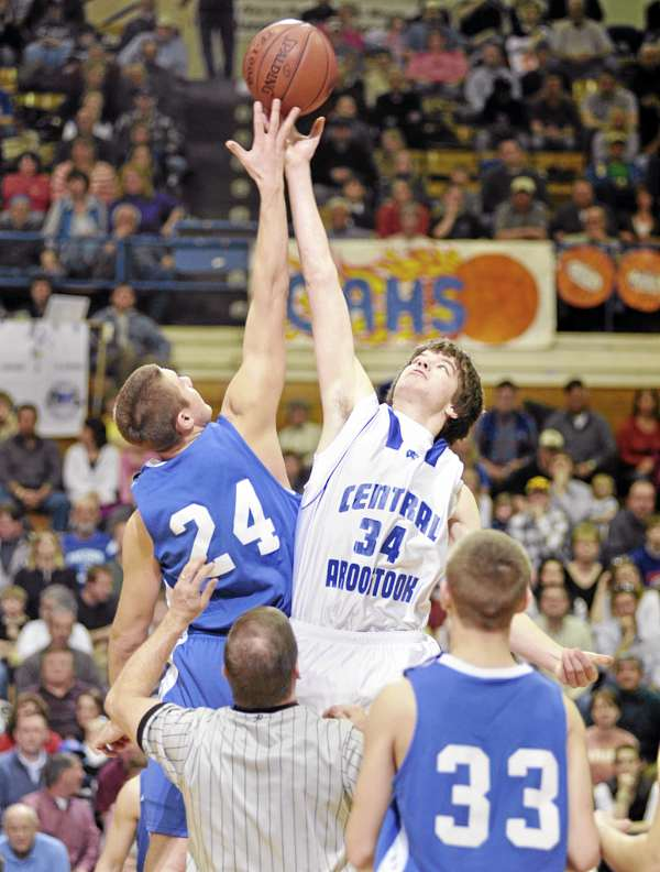 Jonesport-Beals High School's Garet Beal (left) and Central Aroostook's Mike McClung tip off at the start of the Eastern Maine Class D final at the Bangor Auditorium Saturday. Central Aroostook won the title and McClung has been named the William C. Warner MVP for the Class D tourney.