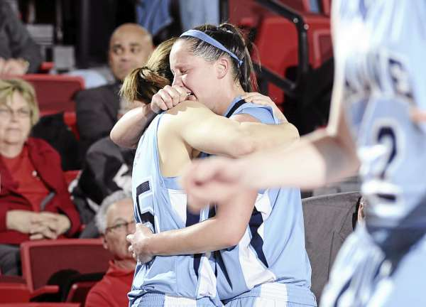 Senior gaurd Tanna Ross hugs teammate Katelyn Vanderhoff as she goes to the bench for the final time Wednesday night.  Stony Brook University defeated the Black Bears 76-55 to end Maine's season.