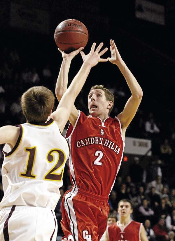 Camden Hills Regional High School's Joel Gabriele (2) shoots Friday, March 4, 2011 during the Class B state basketball finals against Cape Elizabeth High School at the Cumberland County Civic Center in Portland.