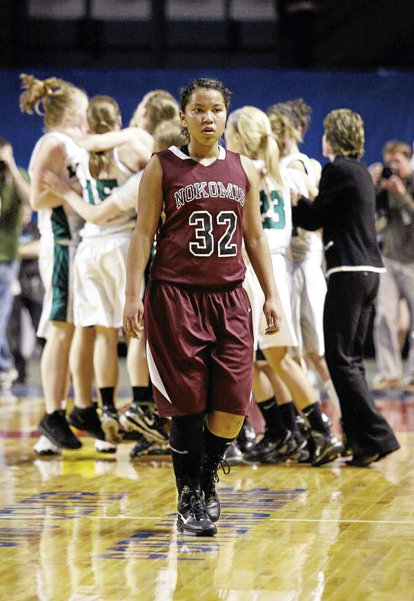 Nokomis' Juliane Smith (32) walks towards the bench after her team lost Friday, March 4, 2011 during the Class B state basketball finals against Leavitt Area High School at the Cumberland County Civic Center in Portland.
