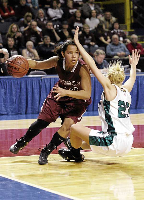 Nokomis' Juliane Smith (32) drives to the basket Friday, March 4, 2011 during the Class B state basketball finals against Leavitt Area High School at the Cumberland County Civic Center in Portland.