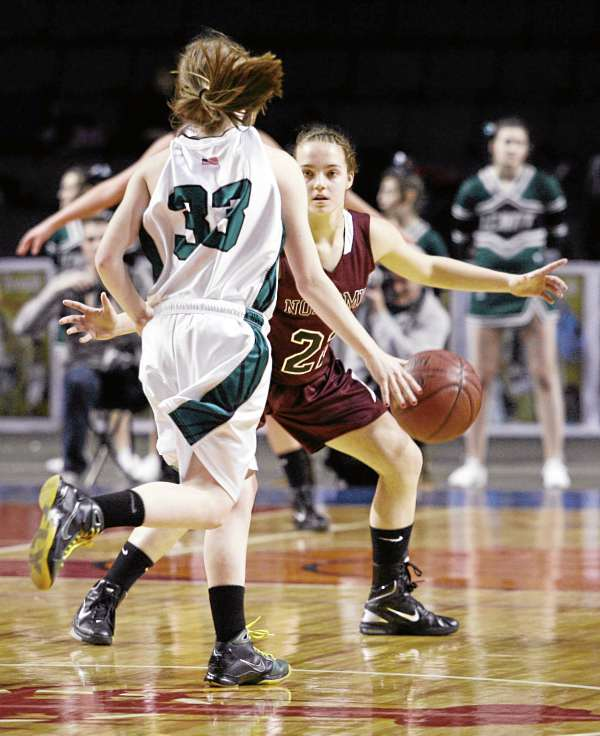 Nokomis' Kylie Richards (22) guards Courtney Anderson (33) Friday, March 4, 2011 during the Class B state basketball finals against Leavitt Area High School at the Cumberland County Civic Center in Portland.