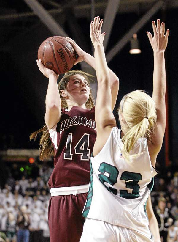 Marissa Shaw (14) of Nokomis of Newport shoots over Amanda Jordan of Leavitt of Turner Center during Friday night's state Class B girls basketball championship game at the Cumberland County Civic Center in Portland. Leavitt defeated the Warriors 49-37.