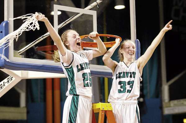 Sophomore Kristen Anderson (left) and senior sister Courtney Anderson of Leavitt of Turner Center celebrate after the Hornets' state Class B girls basketball victory Friday night. Leavitt defeated Nokomis of Newport 49-37 at the Cumberland County Civic Center in Portland.