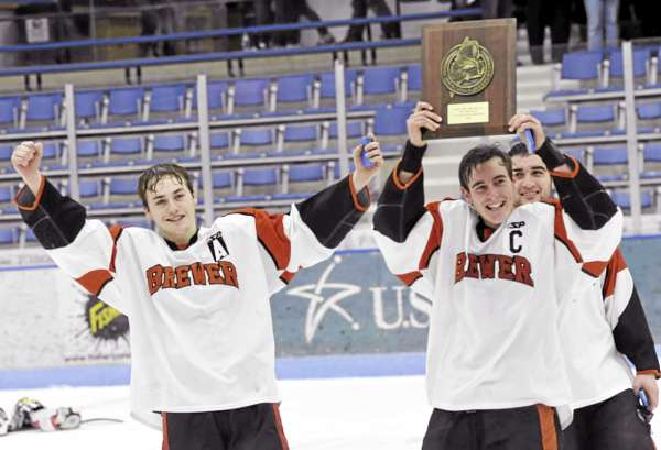 Brewer co-captains Jake Valley (left), Evan Nadeau (center) and Lucas Lamond (rear) hold up the Eastern Maine Class B hockey championship plaque after defeating Houlton-Hodgdon 10-0 in Tuesday night's regional final.