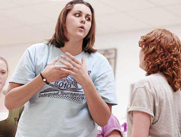 Central High School student Rebekeh Campbell (center) confers with her cat-saturated friend Dani Cookson during rehearsal Wednesday March 2, 2011, in East Corinth.