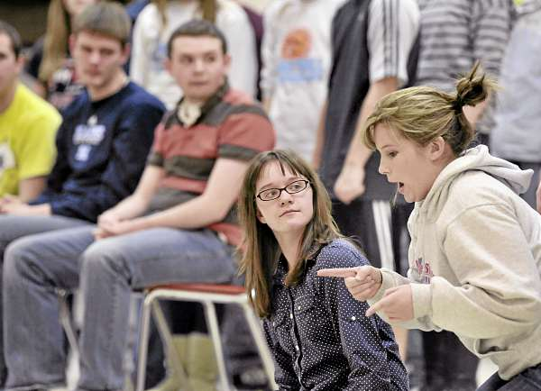 Central High School student Kortlyn Gilley (left) and Katrina Lessard (right) the two cats in the play discuss strategy during rehearsal Wednesday, March 2, 2011, East Corinth.