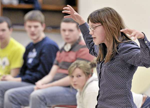 Central High School student Kortlyn Gilley, a cat, pontificates regarding the tenacity of cat hair during a drama rehearsal Wednesday March 2, 2011 in East Corinth.