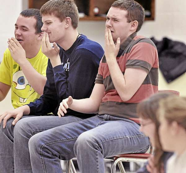 The three &quotmoderators,&quot Central High School students Craig Blackwell (from left), Chris Brownell and Spencer Shaw, enjoy the cleverness of their own joke during the drama rehearsal Wednesday, March 2, in East Corinth.