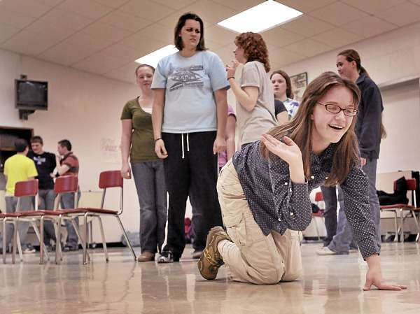 Central High School student Kortlyn Gilley (right) one of the two cats in the play, scoffs and walks away from her 'owner' and her friend as they discuss the lethality of cat hair.