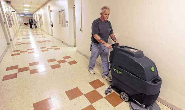 Jeff Welch cleans the floor in the office wing at the  Dorothea Dix Psychiatric Center in Bangor on Thursday, March 10, 2011.