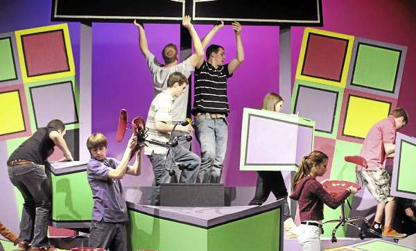 The Rockland District High School tech crew practices striking the set  during the rehursal of the school's production of the Sideways Stories From Wayside School.  They are among the schools that compete in the annual Maine Drama Festival.
