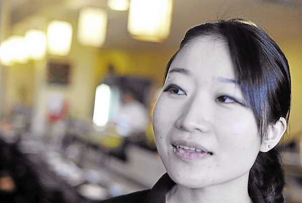 Kanaho Dean, a server at Yoshi Japanese Restauarant in Brewer, was relieved when contacting her sister by e-mail that none of her immediate family in Japan was hurt in Friday's earthquake.