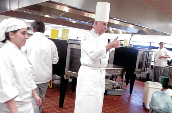 Professional chef Gary Sheldon gives an encouraging thumbs-up to a participant in the culinary arts competition at the SkillsUSA Maine Championships held on Friday, March 11, 2011, at United Technologies Center in Bangor. The annual event is a state-level competition for high school and college students enrolled in trade, technical, and skilled service instructional programs.