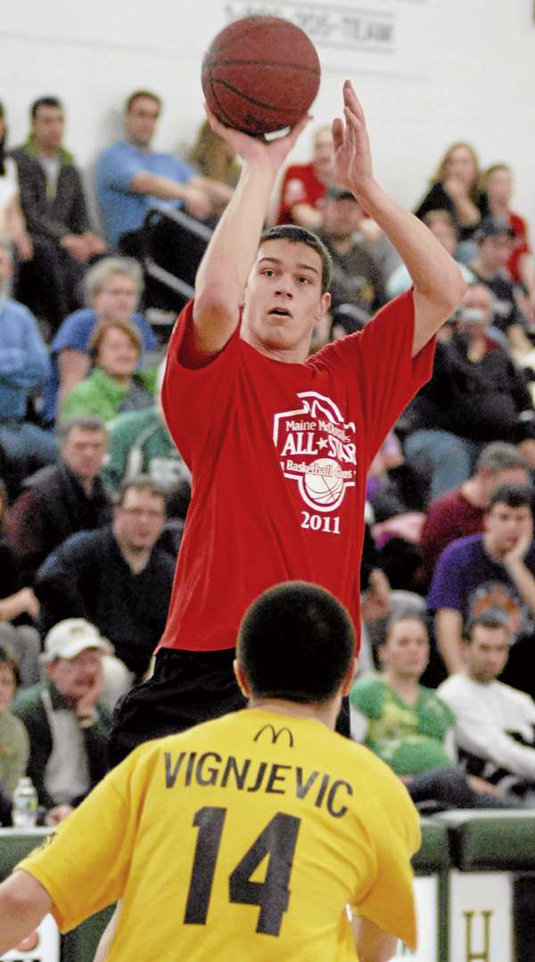 A/B East's Tyler McFarland, Camden Hills Regional H.S., takes a shot in the 2011 Maine McDonald's High School All-Star basketball games at Husson Universtiy on Saturday March 12, 2011. The boys class A/B West team defeated the A/B East team 105-83.