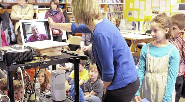 Cherrie MacInnes, a third-grade teacher at the Washington Street School in Brewer, adjusts the computer monitor as her students were talking to former first lady Barbara Bush by video conference from the school. The 23 students each had a turn to talk to Bush, who patiently answered questions and talked about her experience in the White House. On the right is Kaycee Laffey, 9, awaiting her turn to talk to Bush.