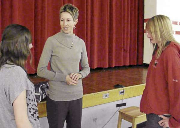 University of Maine women's basketball coach Cindy Blodgett chats with Dexter Regional High School freshmen Katie Merrill (left) and Jessica Chabot on Wednesday during a Teen Issues Fair in the high school gym. The event promoted self-esteem improvements in students.