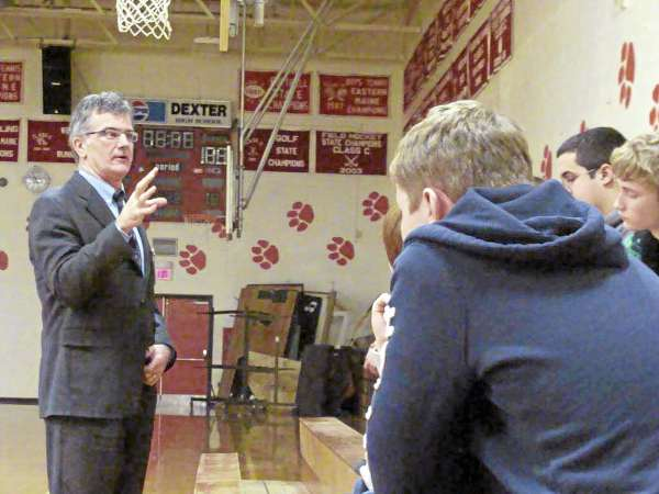 University of Maine football coach Jack Cosgrove speaks Wednesday with students at Dexter Regional High School during its Teen Issues Day. Cosgrove told students to have courage and stand up for what is right as part of helping students improve their self-esteem.