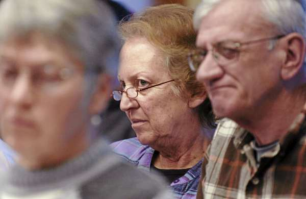Ellen and Arthur Butterfield of Clifton, center and on right, listen to the discussion pertaining to the Clifton's land use ordinances during the town meeting on Saturday.