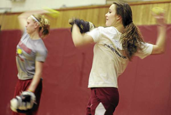 Anna Morris (right) and Kim Jordan of the Bangor High softball team take part in throwing drills during the first day of preseason tryouts for pitchers and catchers Monday afternoon.