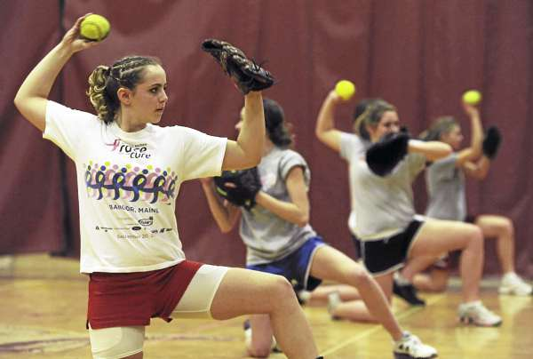 Courtney Lizotte of Bangor High School participates in a drill as pitchers and catchers work out at Red Barry Gym Monday afternoon. Monday marked the first day of preseason tryouts for high school pitchers and catchers.