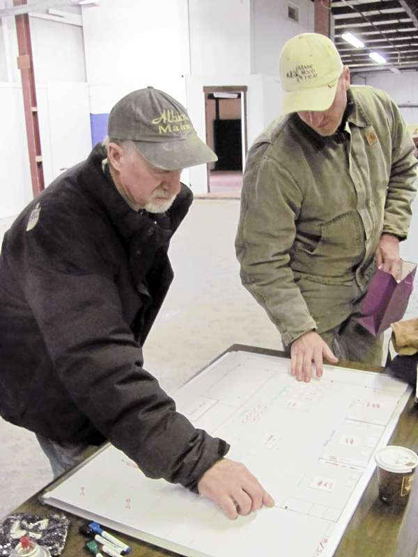 Albie (left) and Scott Barden look over the floor plan of their new 12,000-square-foot headquarters in Skowhegan. The move from their home-based location in Norridgewock is expected to take about three months and as of Monday, March 21, 2011, the process had just begun.