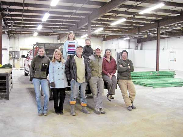 Maine Wood Heat Co., which manufactures European-inspired wood-fired heaters and masonry ovens, has been a family operation from the start some 30 years ago. Shown in this photo are all of the company's current employees. From left are Amy Clark, Cheryl Barden, Albie Barden, Scott Barden, Cate Conway and Brock Harmon. Standing in back are Thalia and Oliver Barden. The business was founded by Cheryl and Albie Barden, who have brought their son Scott in as a partner.
