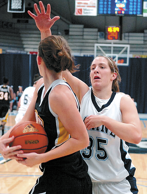 Katelyn Vanderhoff (right) of the University of Maine blocks Maryland Baltimore County's Meghan Colabella during the first period in a recent game at Alfond Arena in Orono. Vanderhoff and teammate Jaymie Druding have left the program and plan to transfer to other schools.