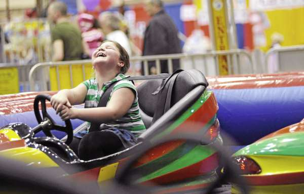 Mabel Eames,7, of Bangor was all giggles as dad Bruce Raymond (not pictured) of Bangor collides with her bumper car-- one of the many amusements at the Bangor YMCA Spring Fair at the Bangor Auditorium Friday.