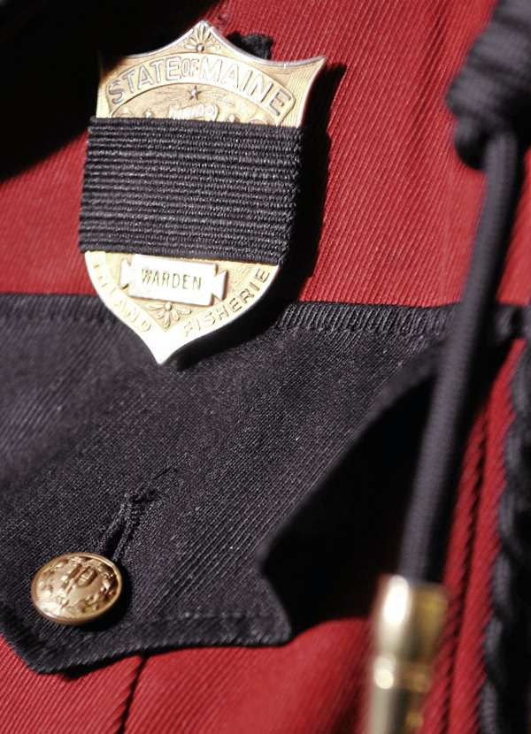 During Friday's press conference in Bangor, this warden's uniform was displayed with black band over badge as a memorial tribute to fallen warden service personnel including Warden Service Pilot Daryl Gordon who died in a plane crash overnight.